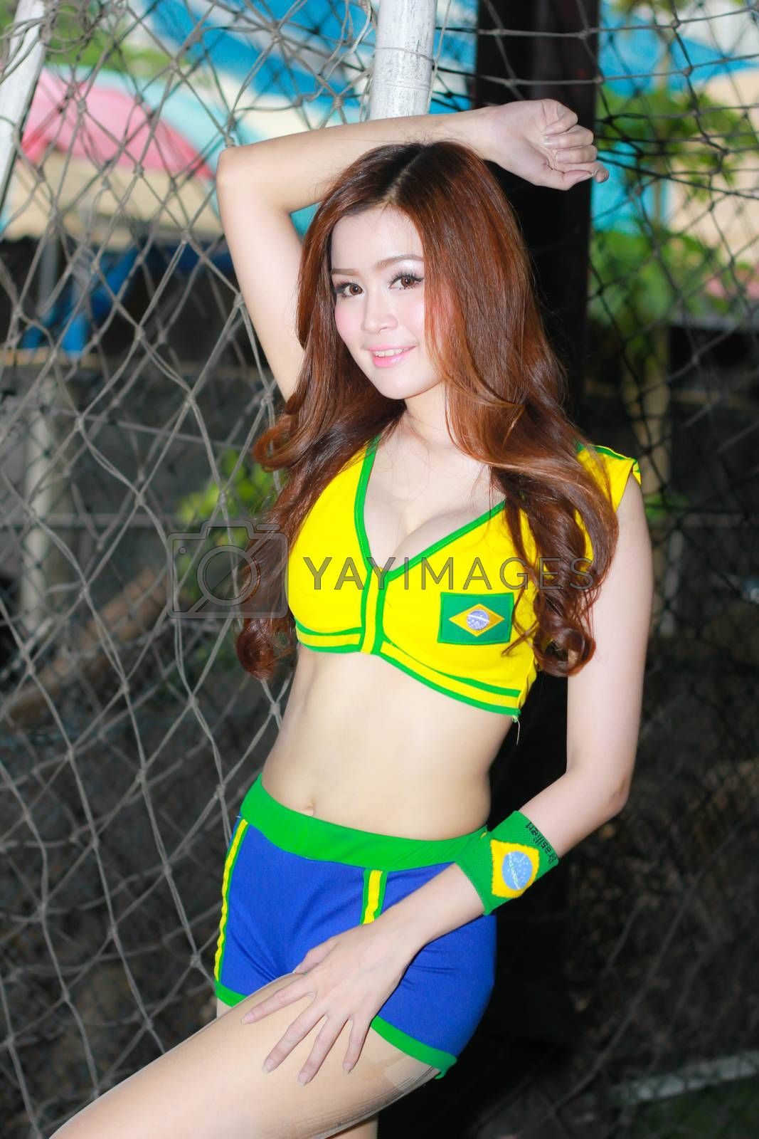 BANGKOK, THAILAND - JUNE 29, 2014: Unidentified model with Brazil costume pose for promote World Cup 2014 in futsal park on June 29, 2014 in Bangkok, Thailand.