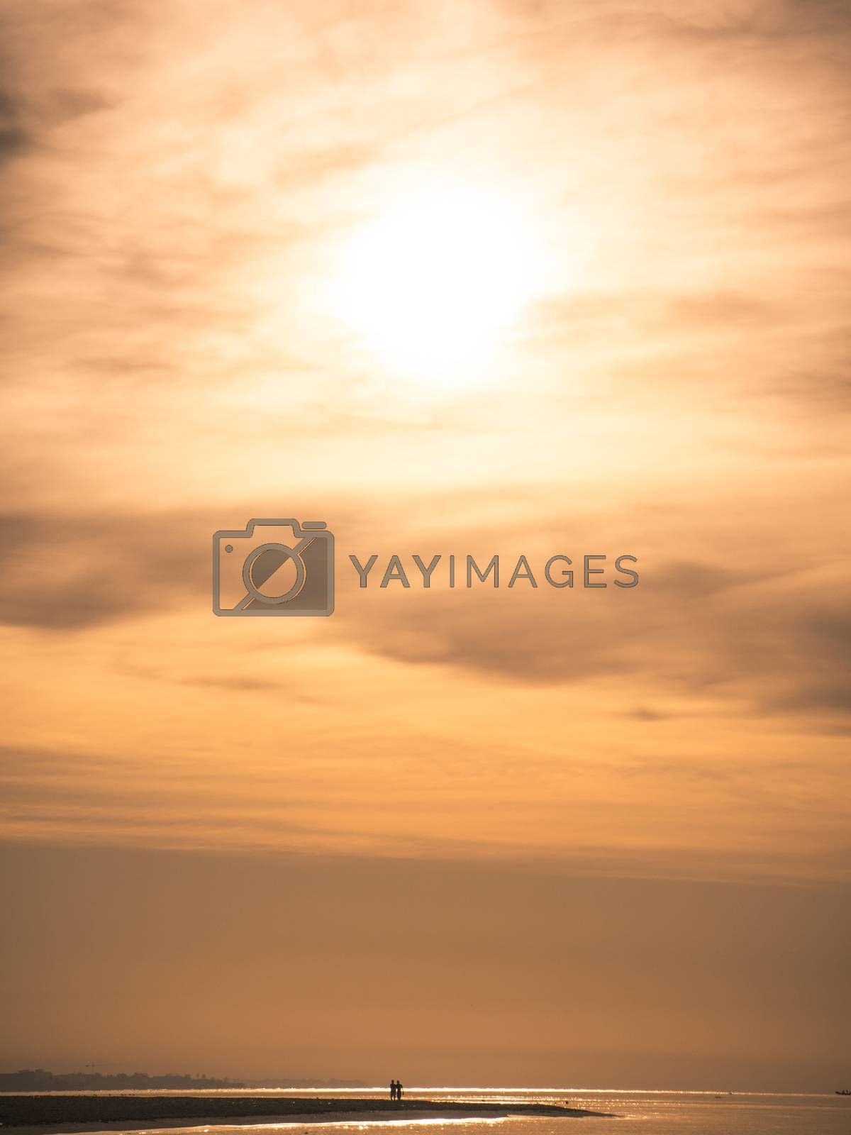 silhouette of couple on the beach at sunset. Love and romance