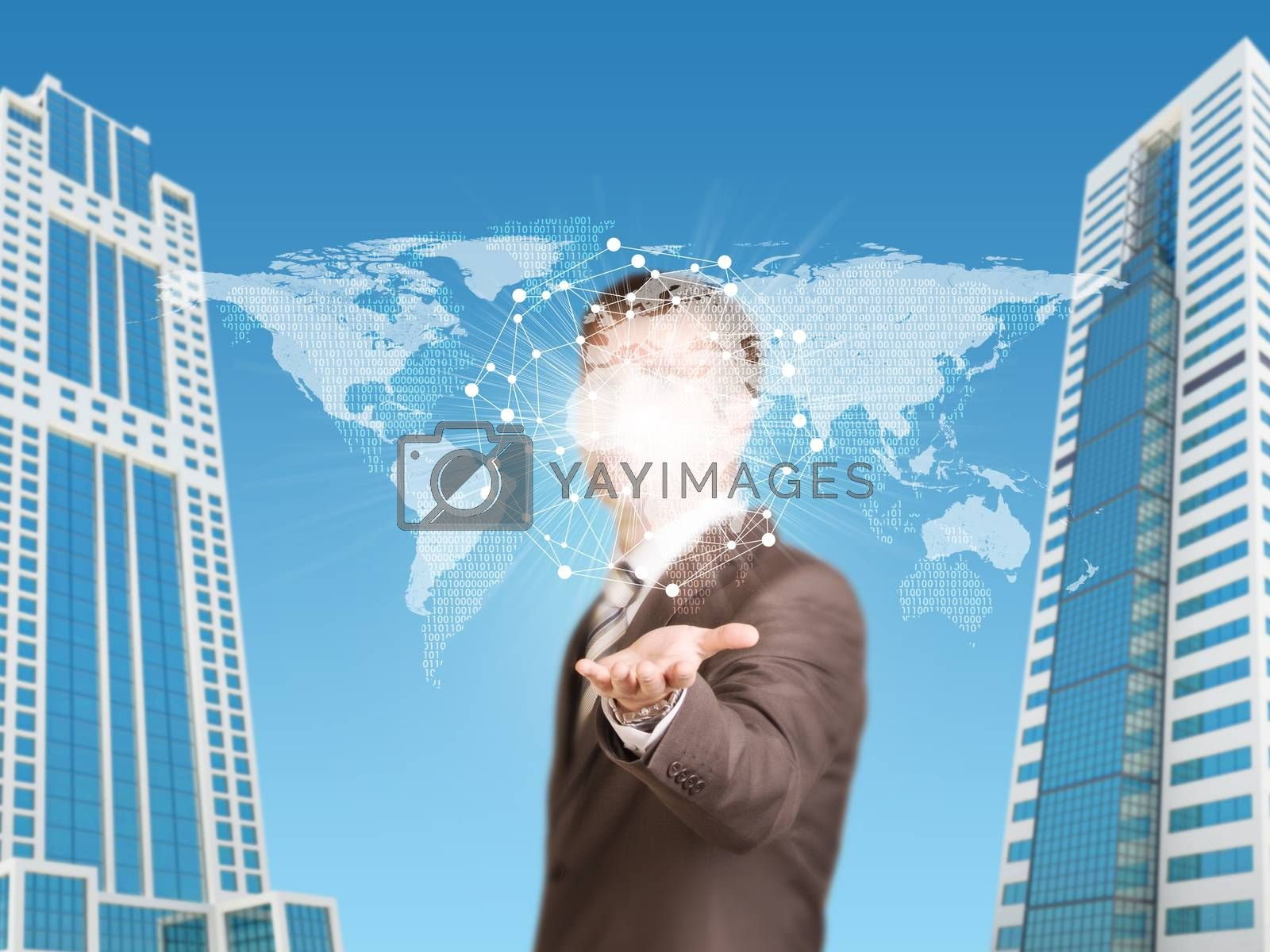 Skyscrapers. Businessman in a suit hold world map