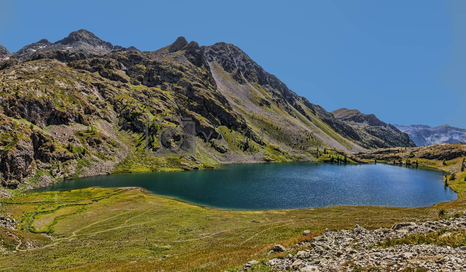 Image of the Big Lake from the Vens Lakes located at 2327 m in Maritime Alps in Mercanotur Park in the south of France. The Vens Lakes are a set of five lakes flowing one in the other
