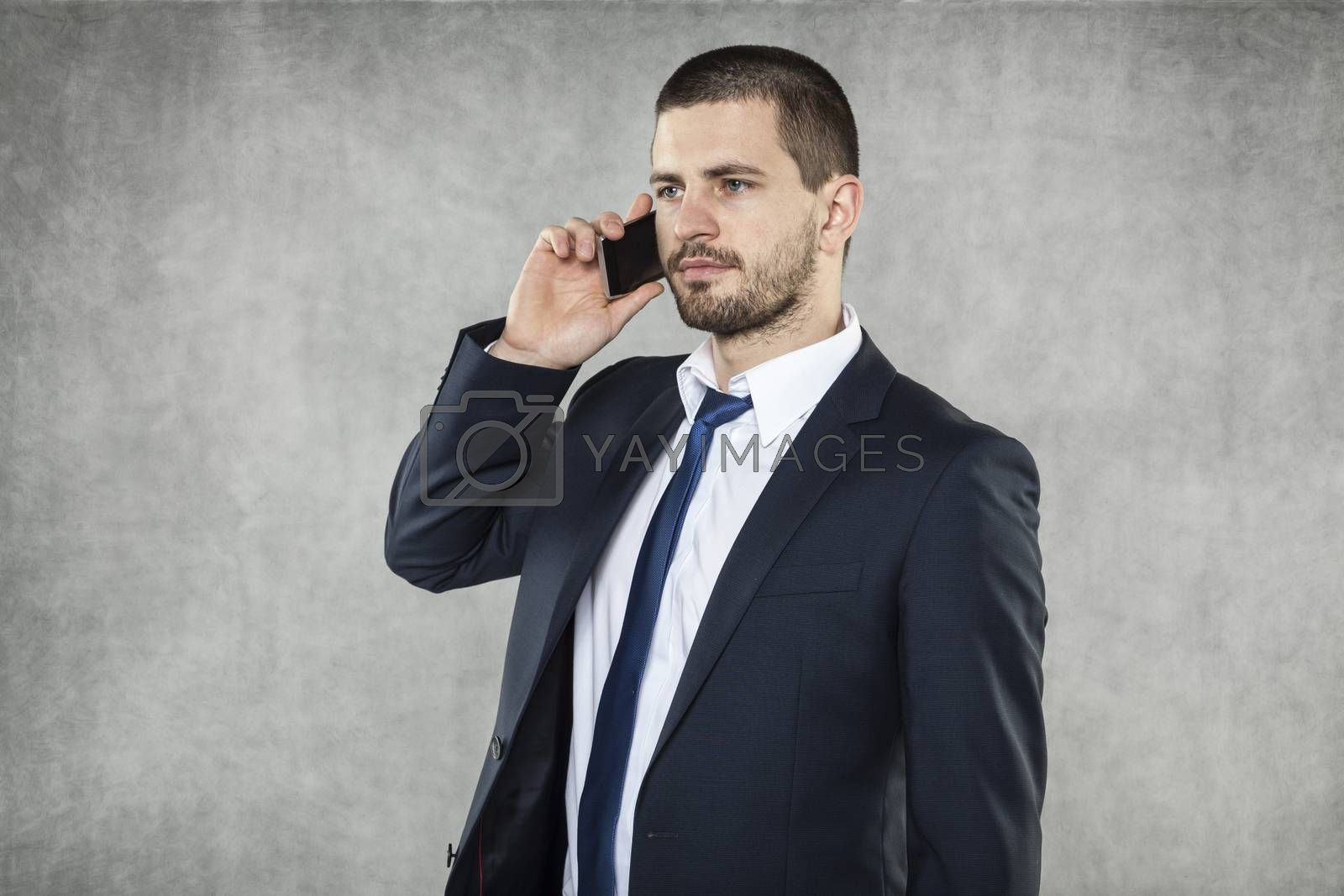 serious businessman talking on the phone