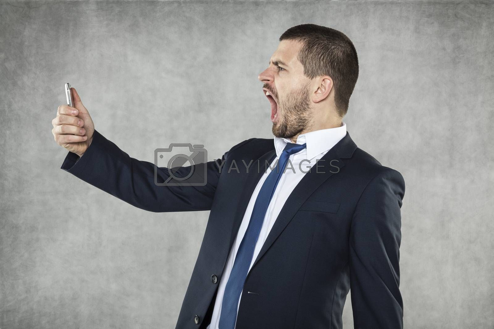 angry businessman shouts