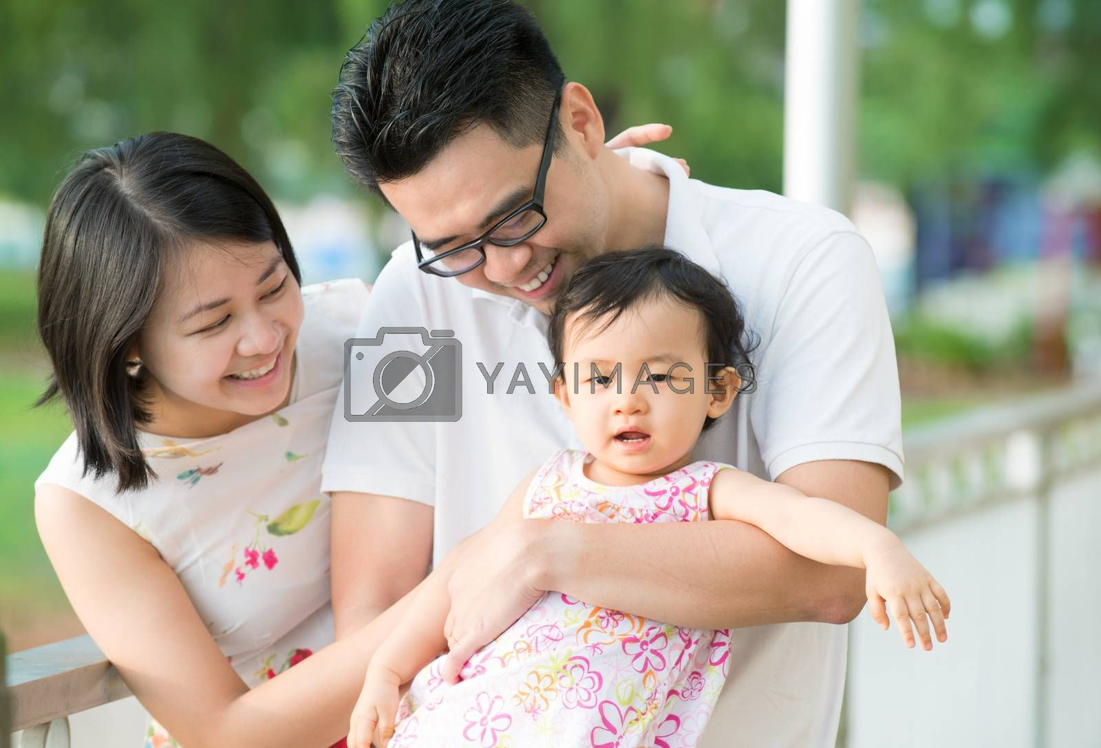 Asian family at outdoor park by szefei