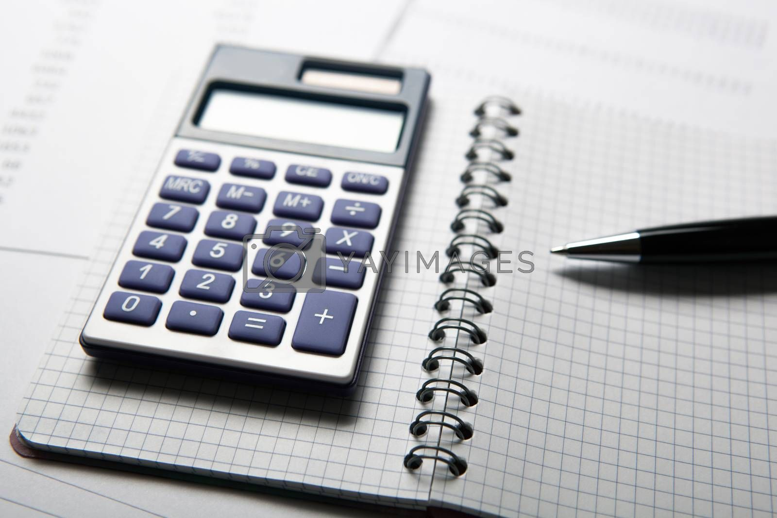 Royalty free image of work on the calculator and papers by mizar_21984