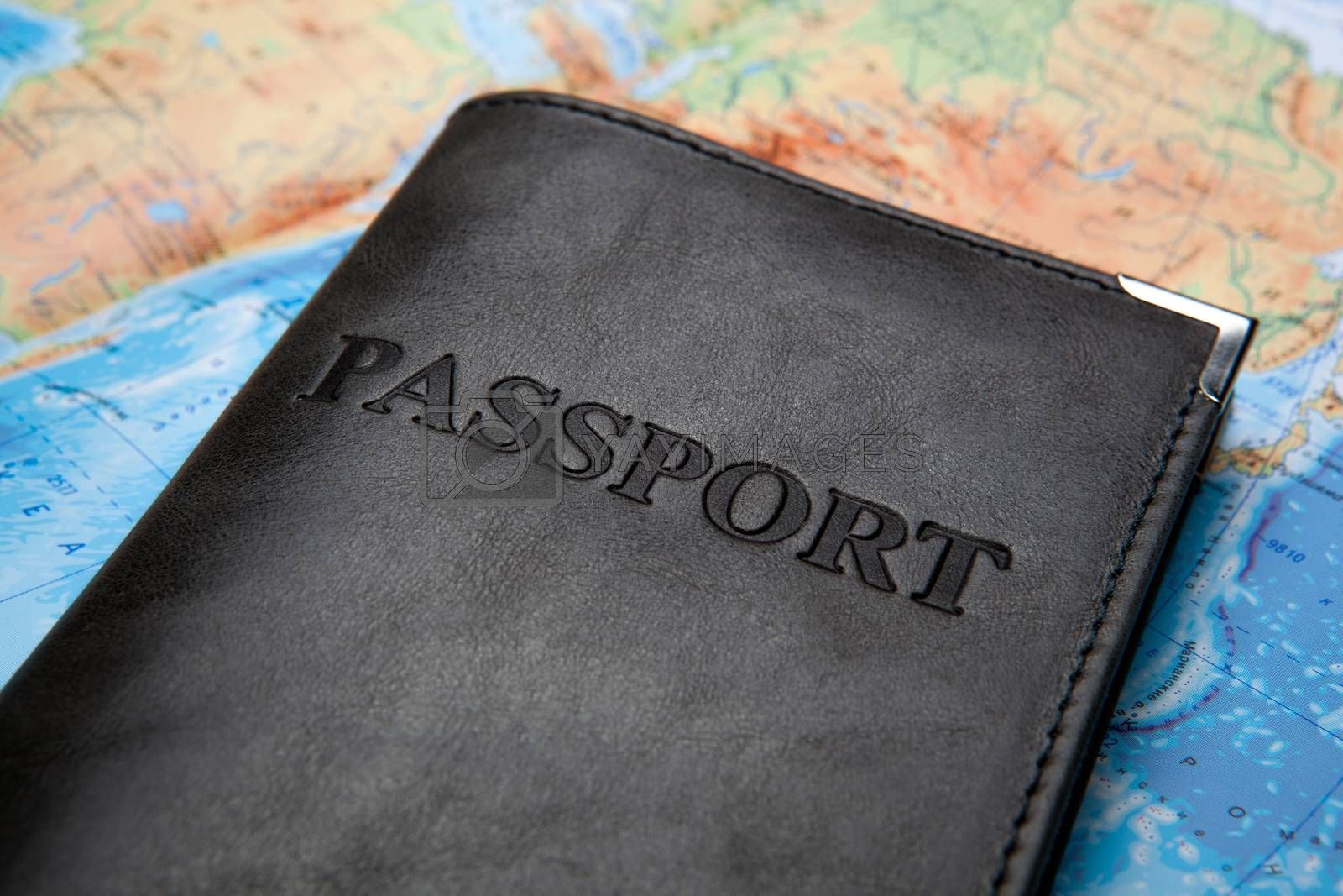 Royalty free image of passport in the bag on a map  by mizar_21984