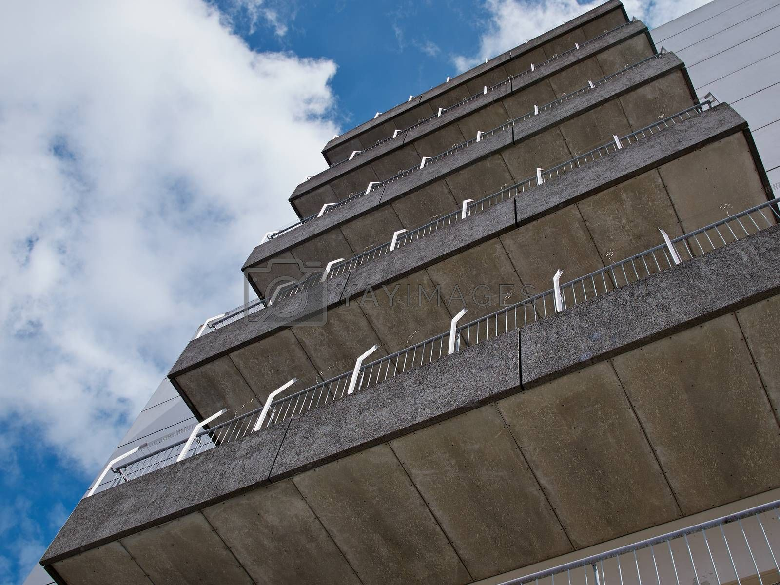 Royalty free image of Modern apartments building architecture background by Ronyzmbow