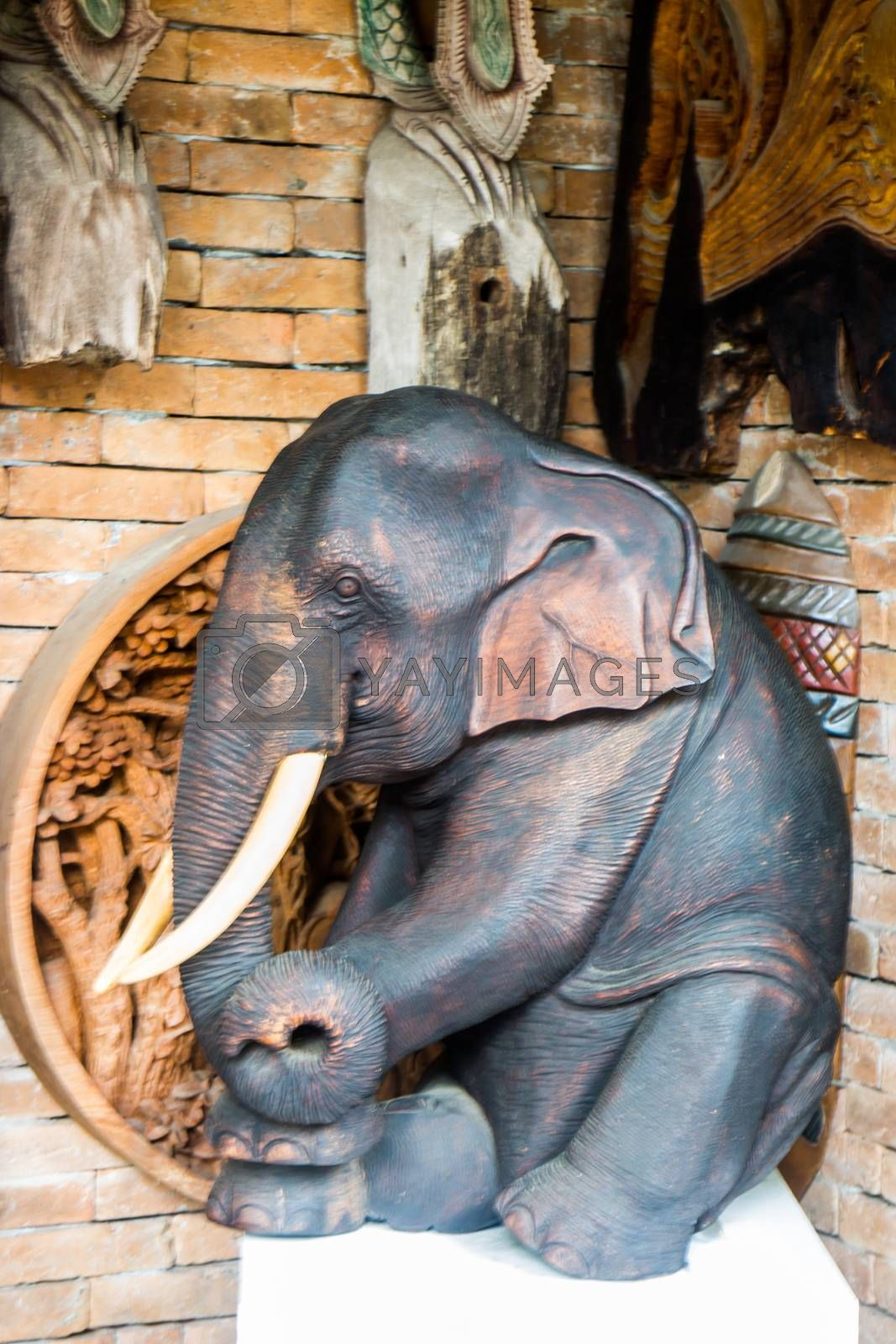 Royalty free image of Beautiful wooden elephant pose sculpture by nalinratphi