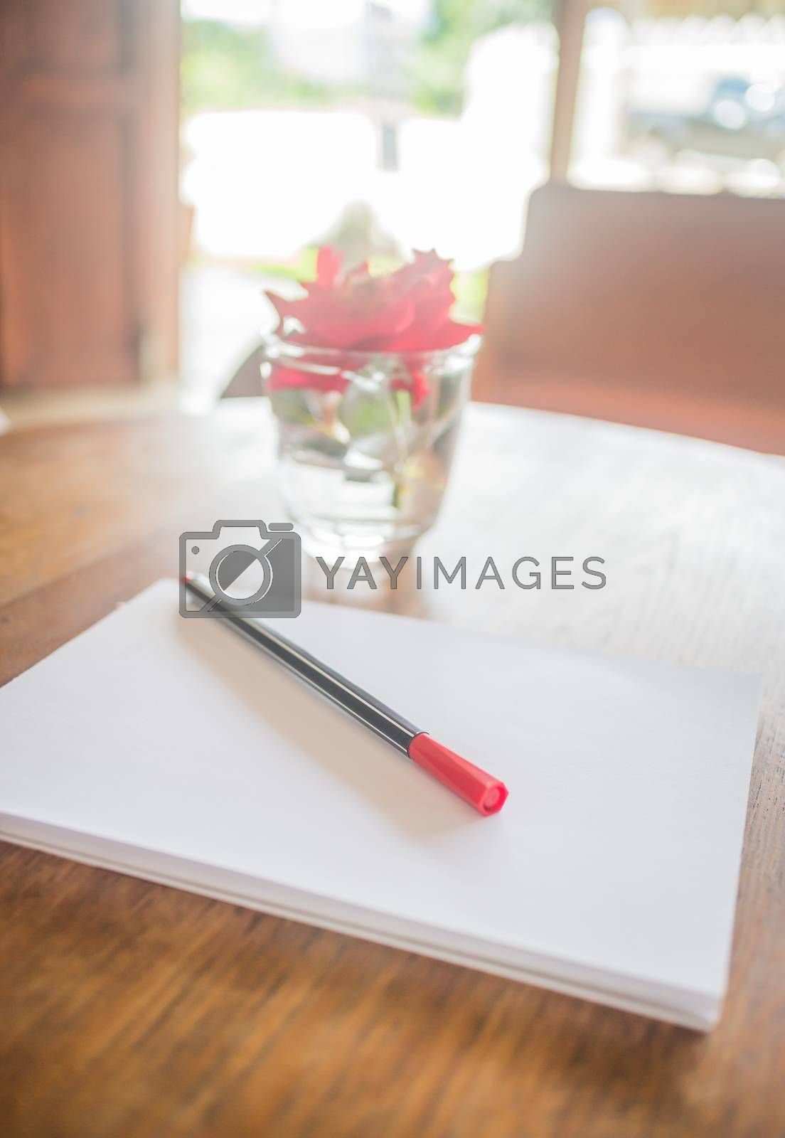 Royalty free image of Romantic work table with rose  by nalinratphi
