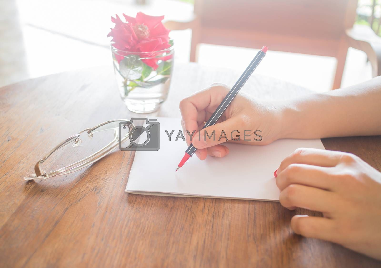 Royalty free image of Writing love letter on romantic table by nalinratphi