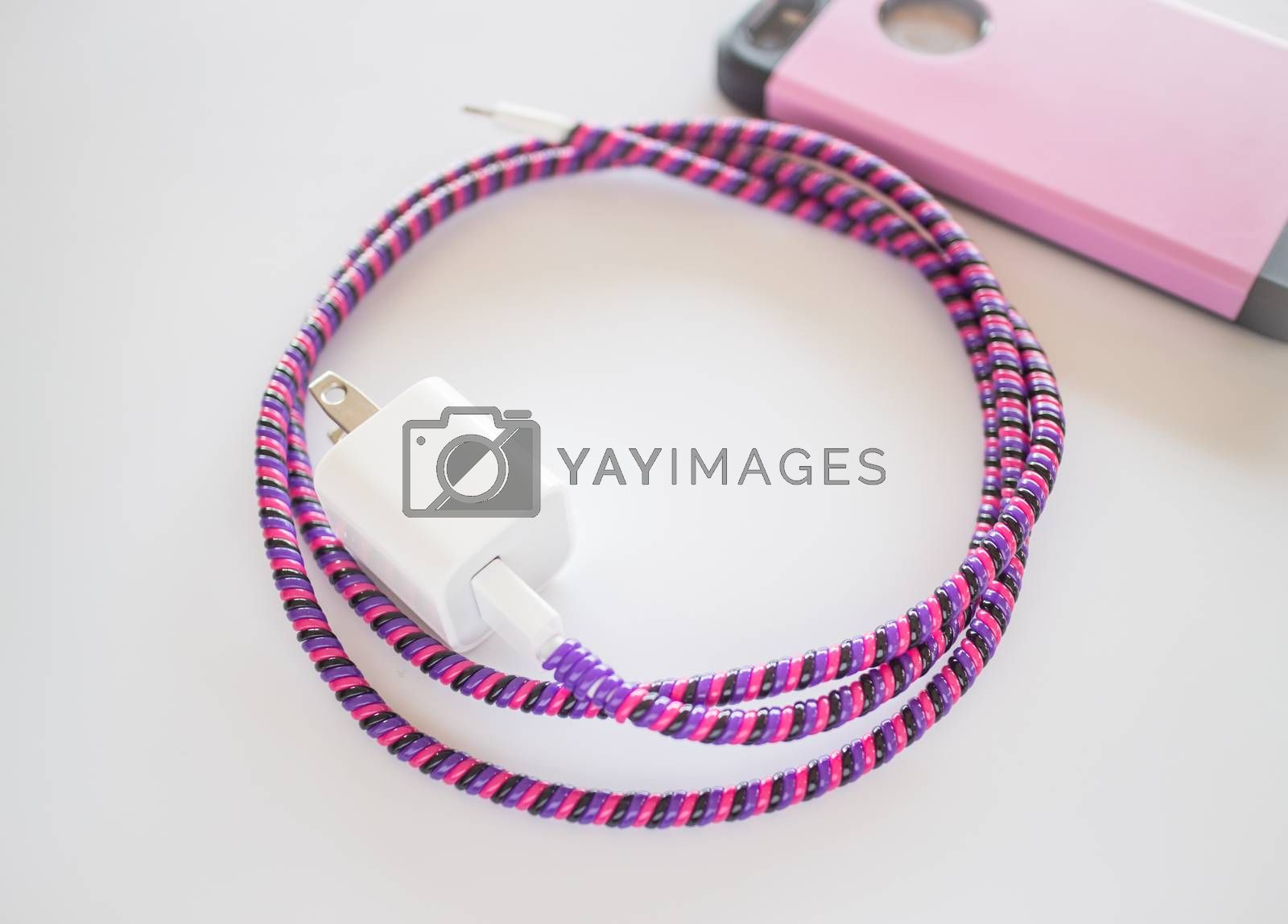 Royalty free image of Smart phone charger with plastic cover on white background by nalinratphi