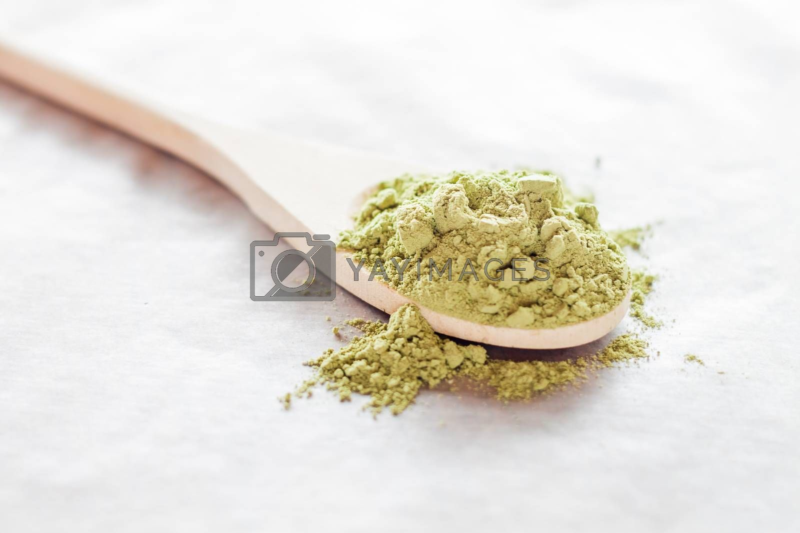 Royalty free image of Spoon of green tea powder  by nalinratphi