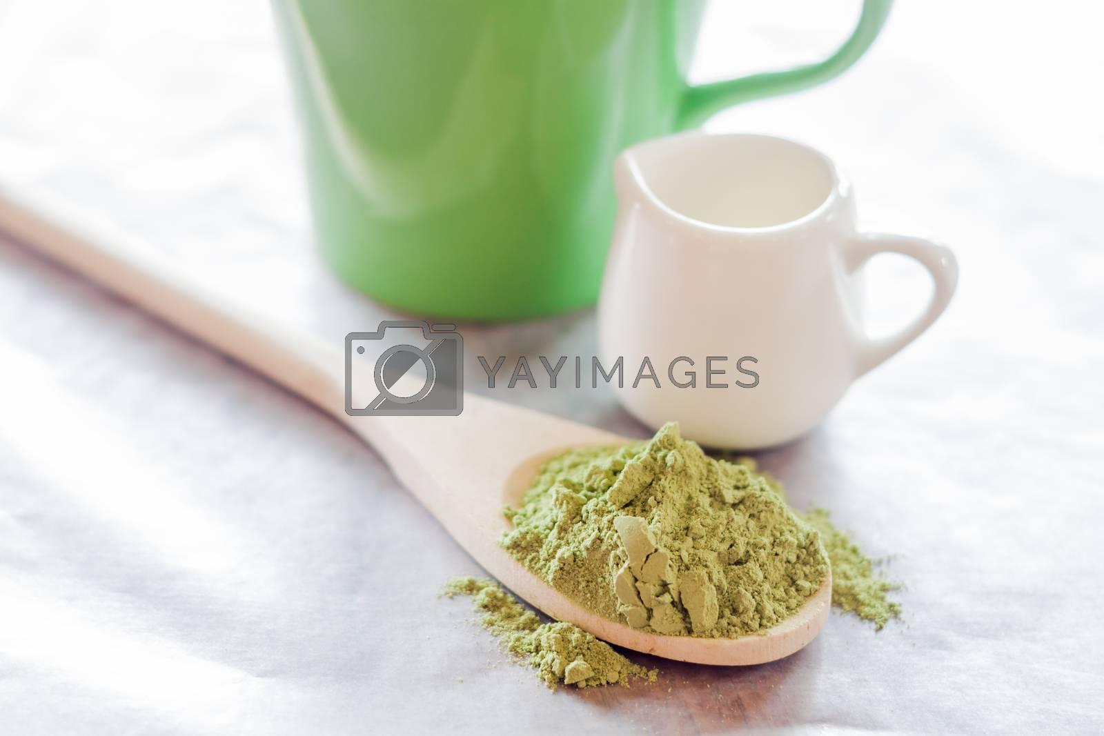Royalty free image of Hot green tea latte ingredient by nalinratphi