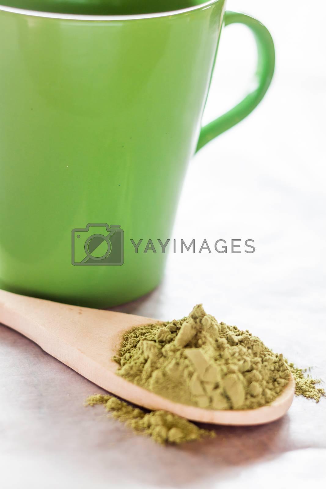 Royalty free image of Making hot drink of green tea  by nalinratphi