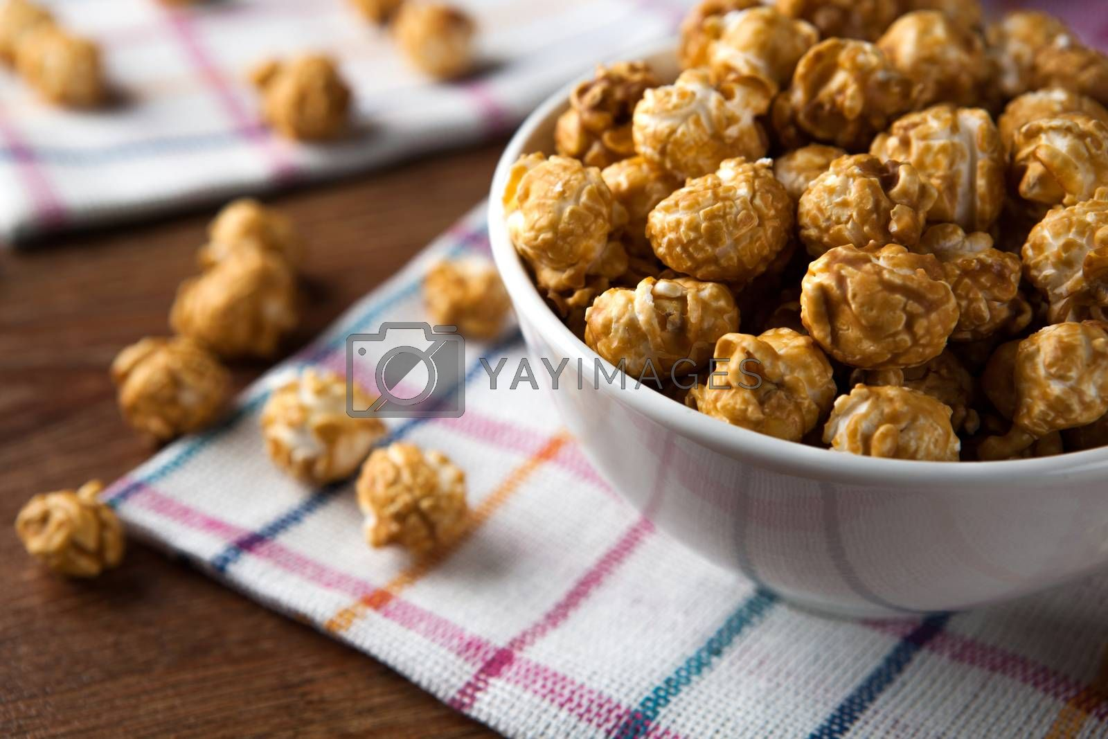 Royalty free image of a lot of golden caramel corn by mizar_21984
