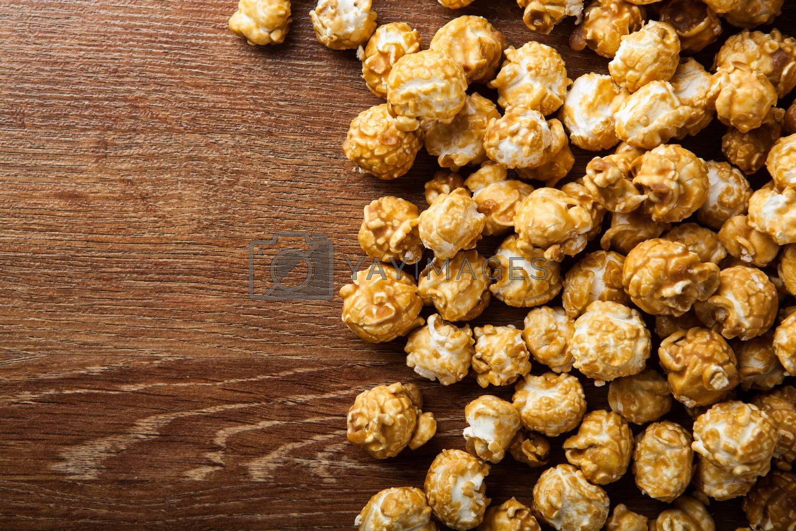 Royalty free image of a lot of golden caramel corn background by mizar_21984