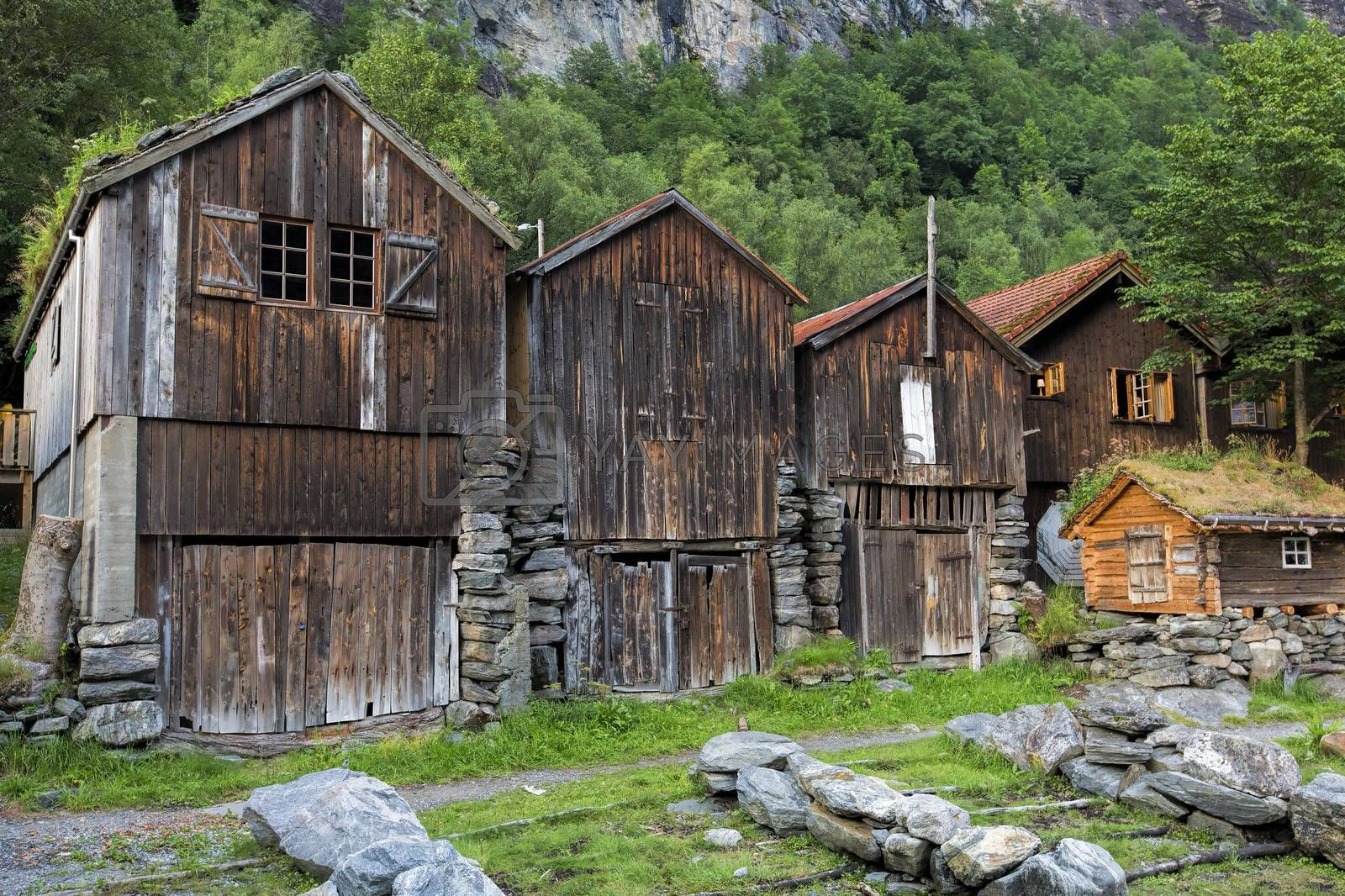 Old wooden houses at the waterfront in Geiranger
