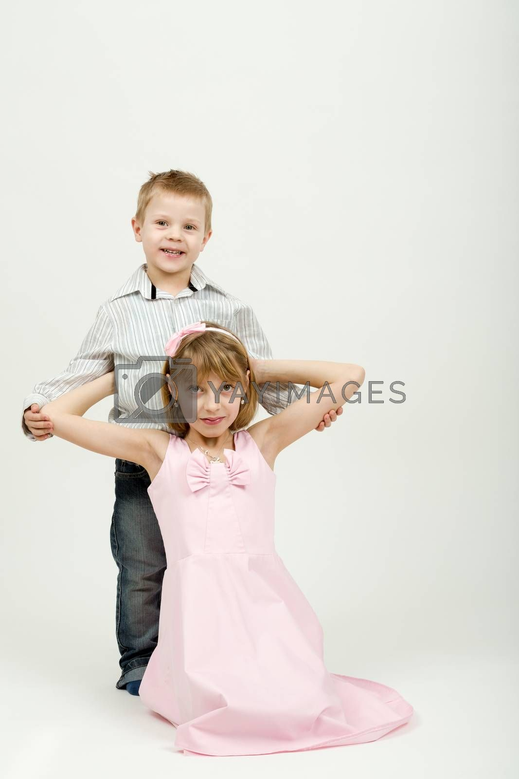 Royalty free image of Studio portrait of siblings beautiful boy and girl by artush