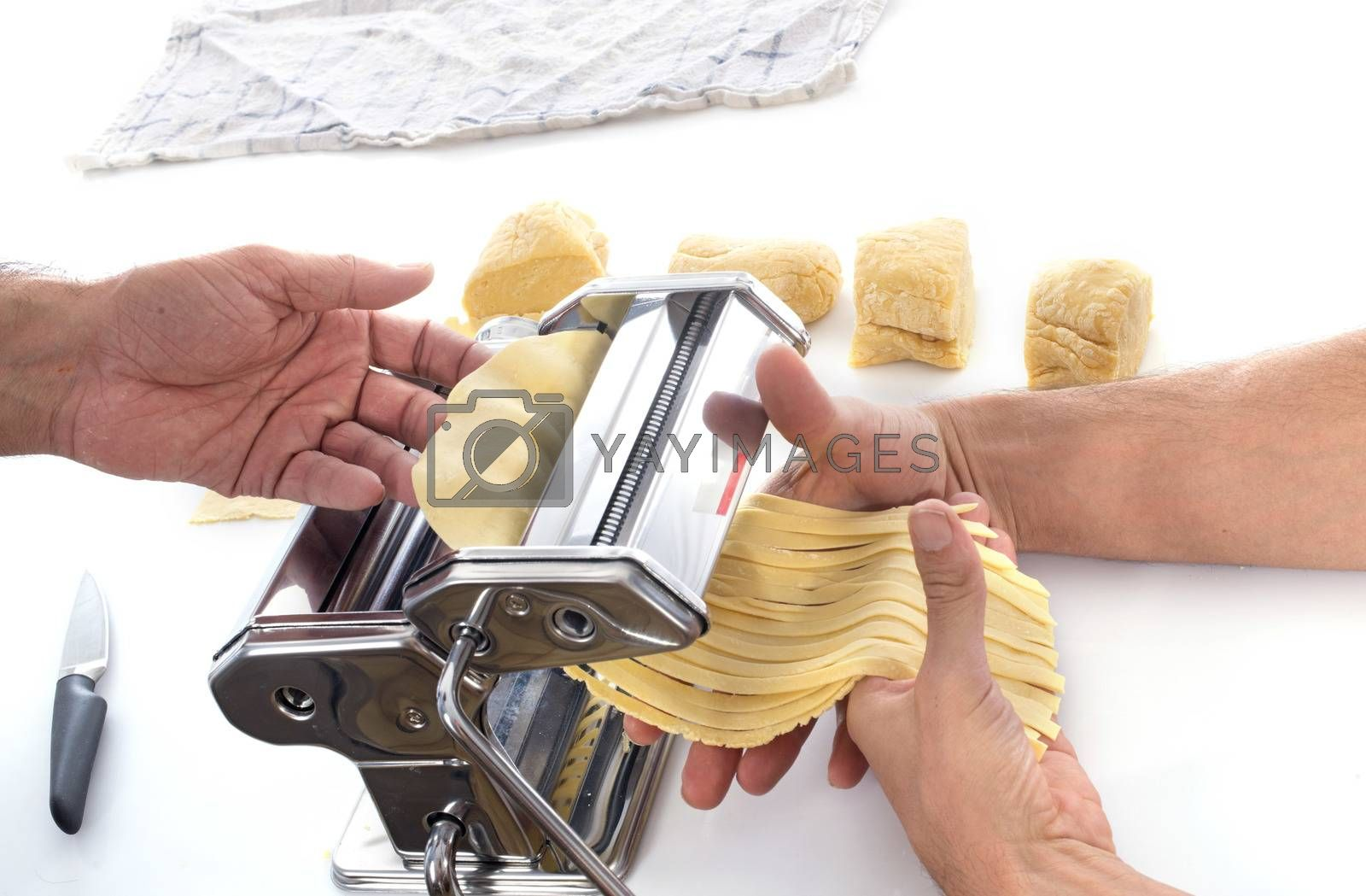 Royalty free image of Using a pasta maker  by cynoclub