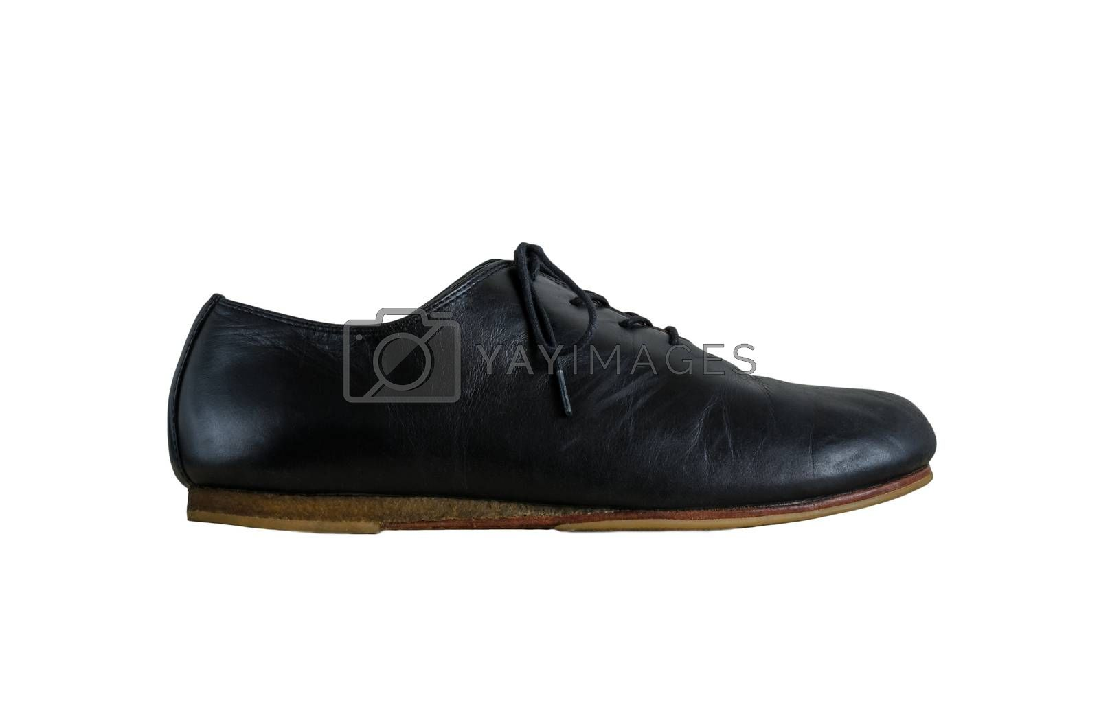 Royalty free image of Side view of black leather shoes isolated on white by siraanamwong