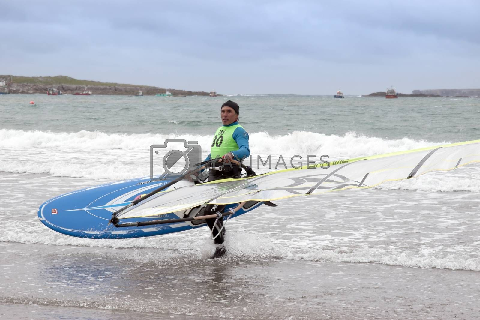 windsurfers getting ready to race and surf on the beach in the maharees county kerry ireland