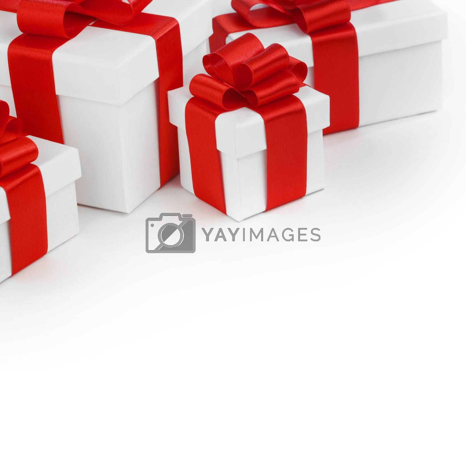 Royalty free image of White gift boxes with red ribbons by Yellowj