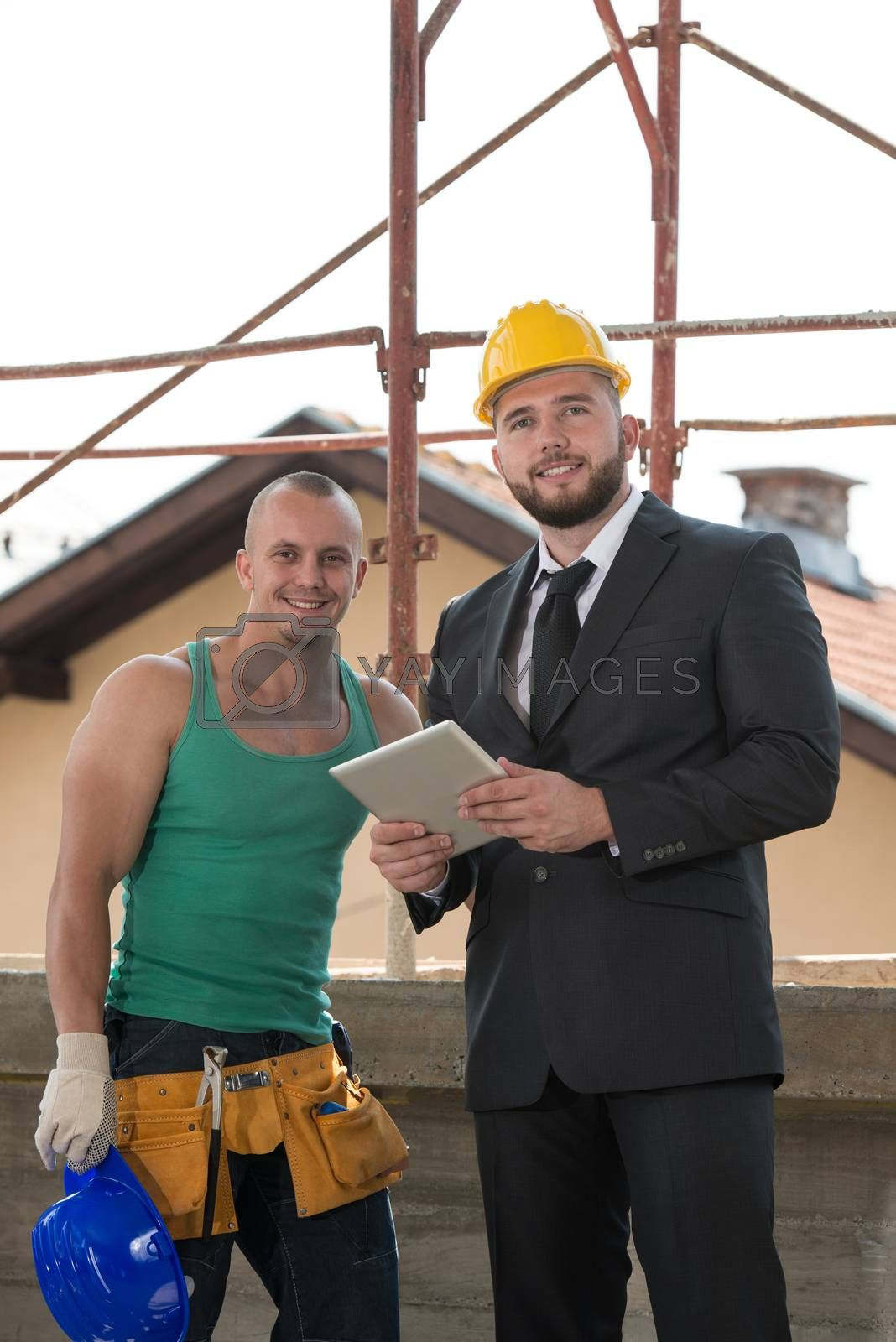 Royalty free image of Portrait Of Builder And Businessman Working At Construction by JalePhoto