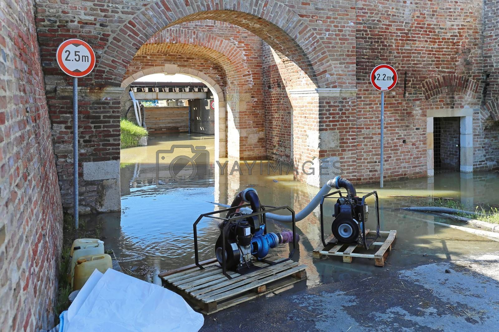 Royalty free image of Pumping flood water by Baloncici