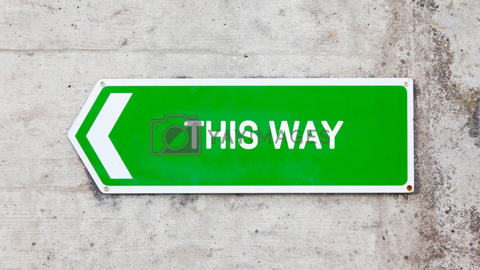 Royalty free image of Green sign - This way by michaklootwijk