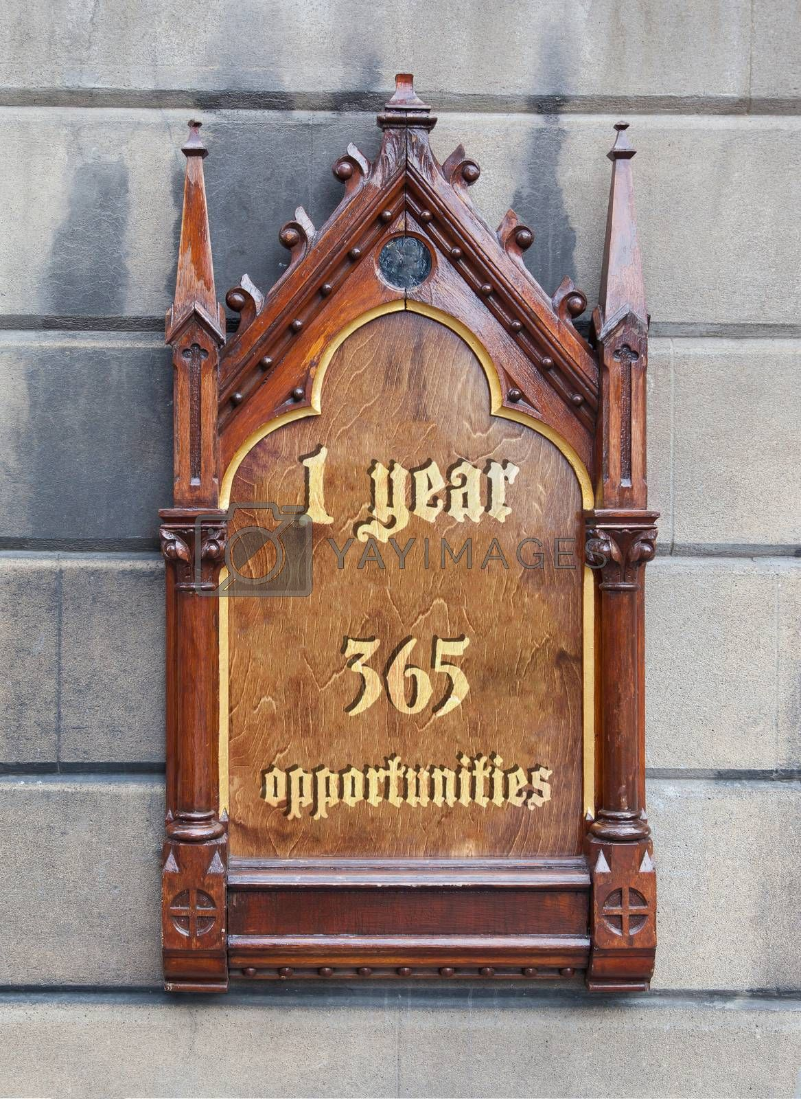 Royalty free image of Decorative wooden sign - 1 year, 365 opportunities by michaklootwijk