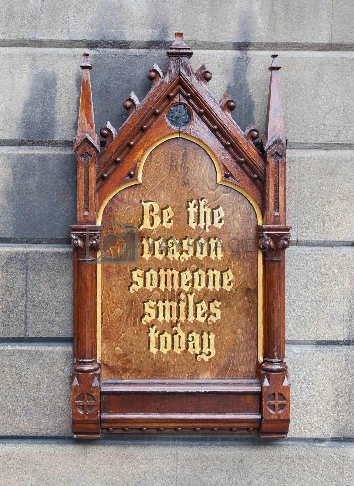 Royalty free image of Decorative wooden sign - Be the reason someone smiles today by michaklootwijk