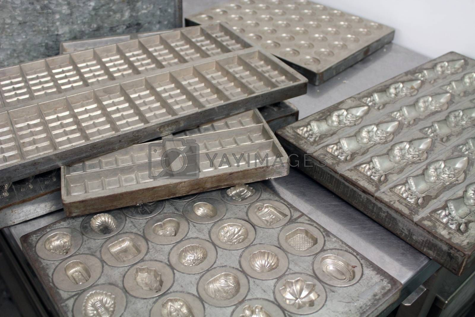 Royalty free image of Iron molds for chocolates by aamulya