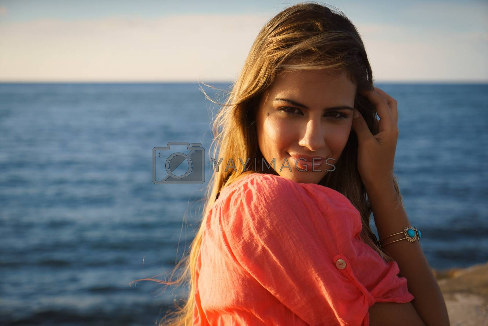 Royalty free image of Portrait young woman smile happy sea beauty by diego_cervo