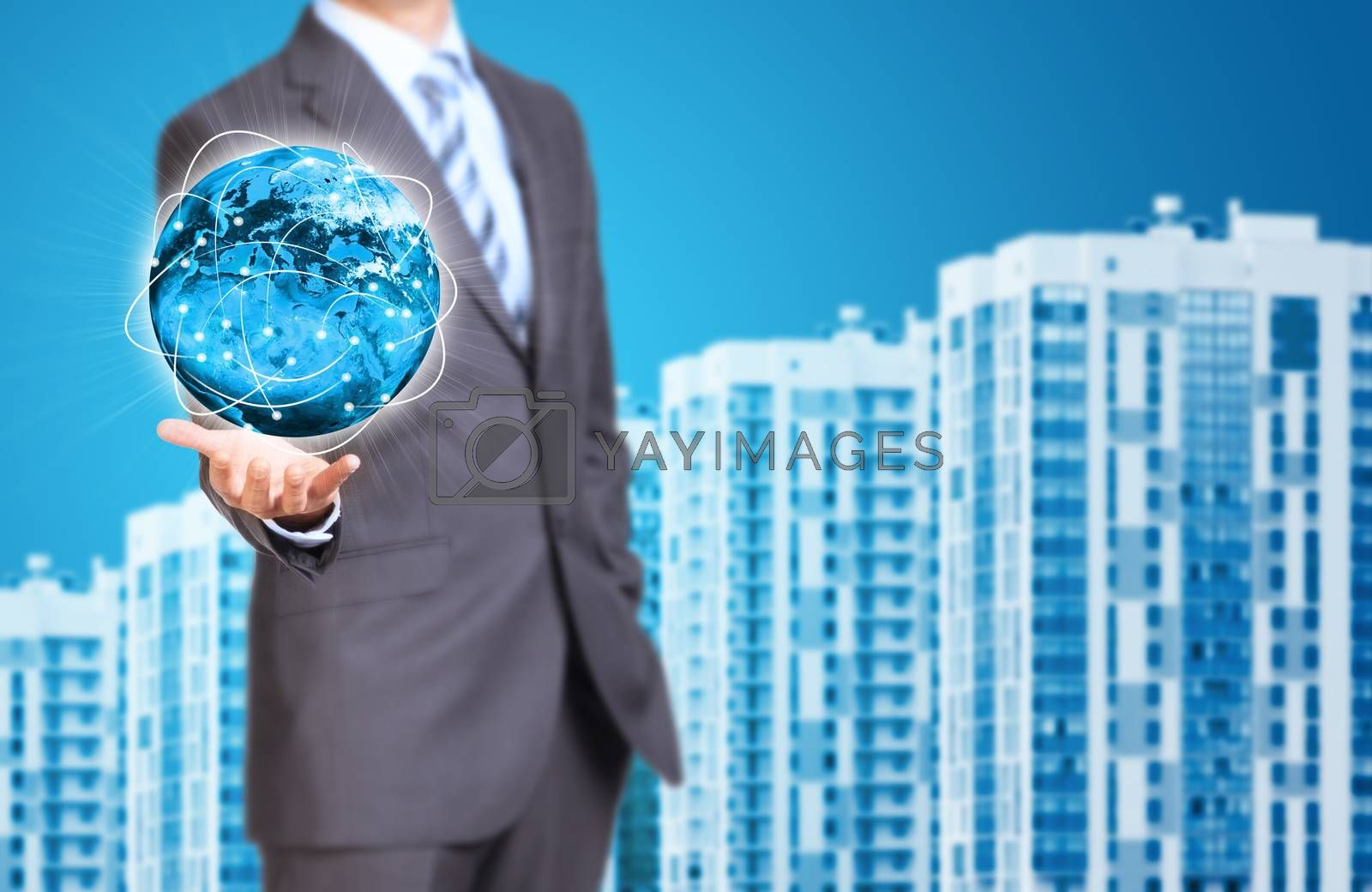 Business man hold Earth in hand. New houses row as backdrop. Elements of this image are furnished by NASA