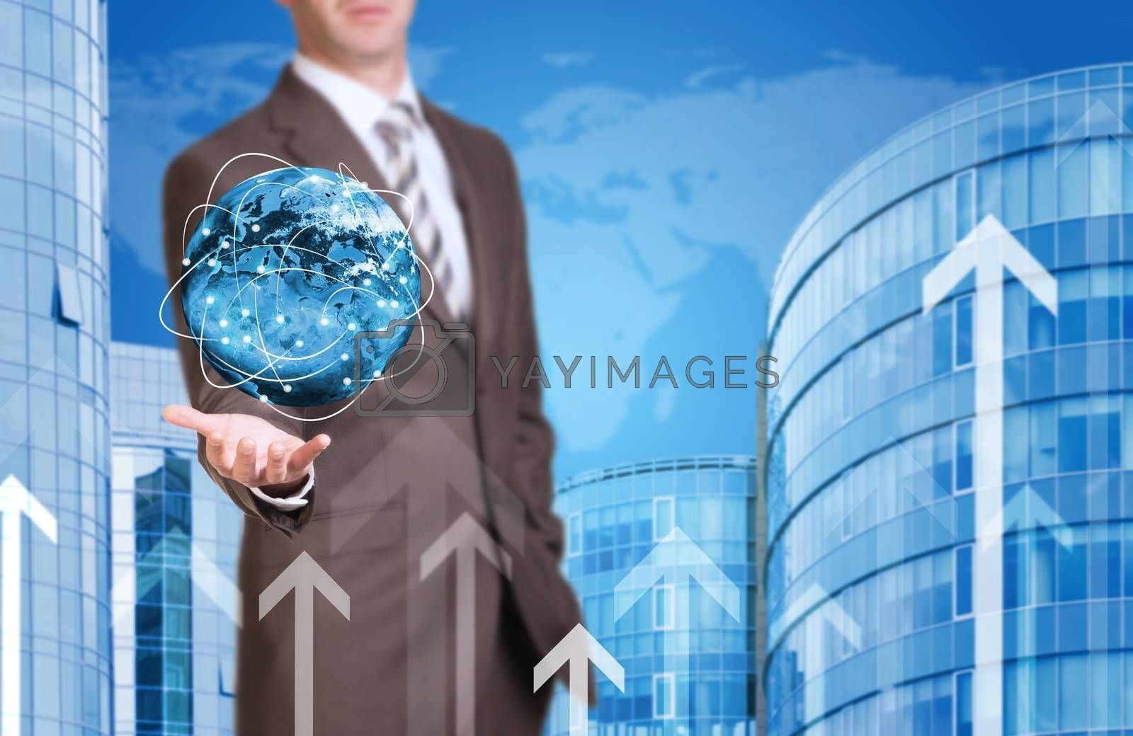 Business man hold Earth in hand. New house and world as backdrop. Elements of this image are furnished by NASA