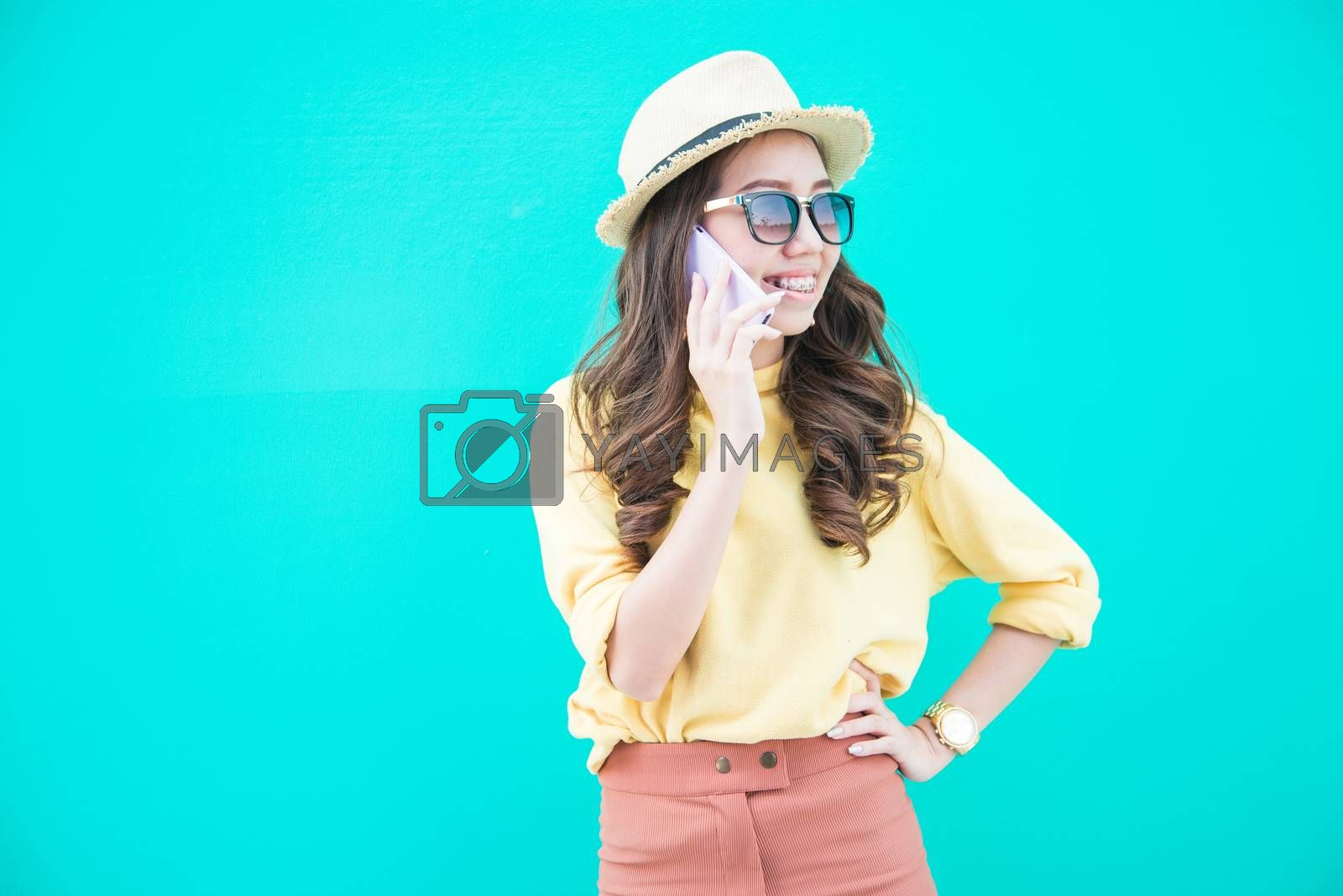 A portrait of beautiful asian woman acting talking mobile phone