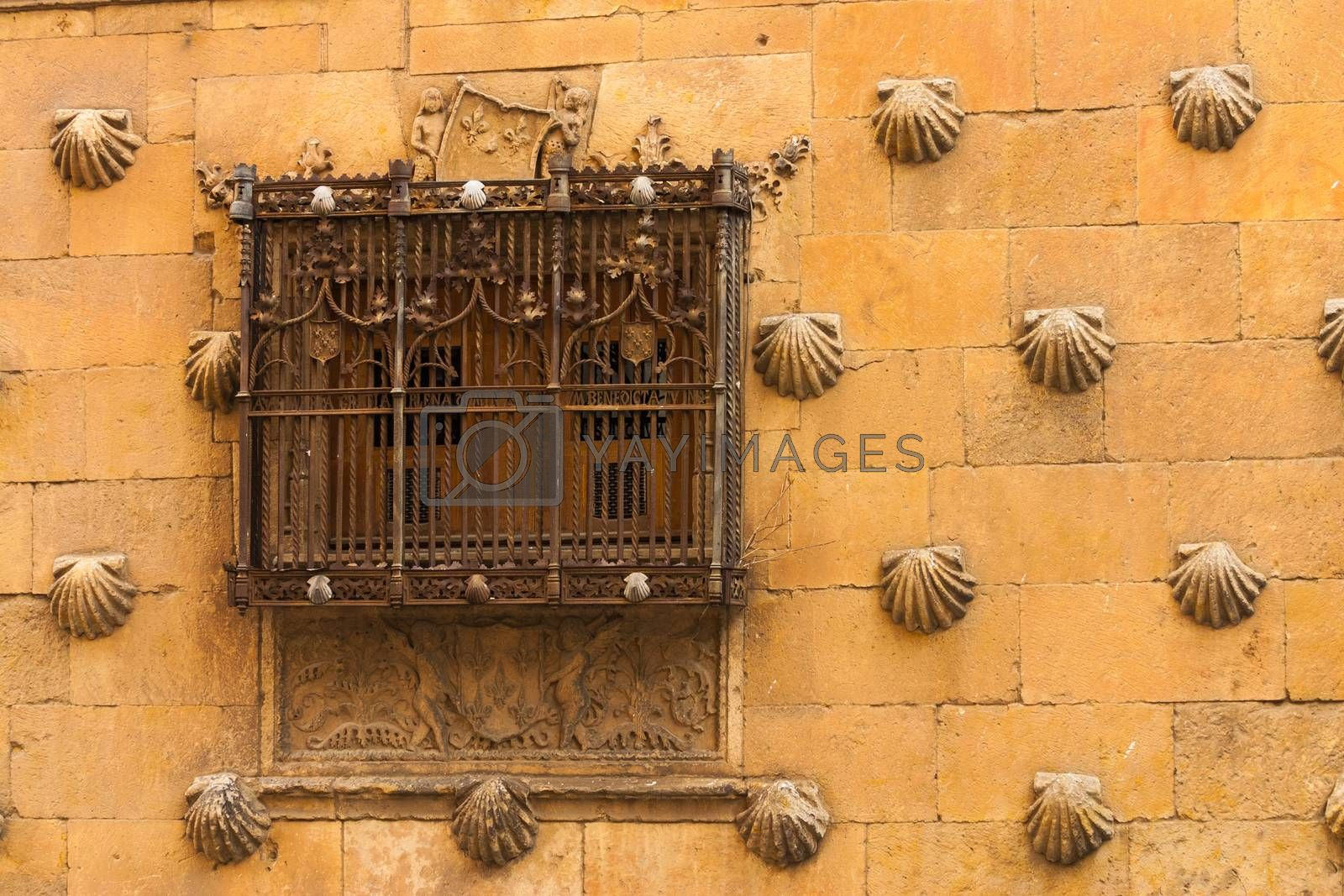 Beautiful window with forge of The House of Shells in Salamanca by imagsan