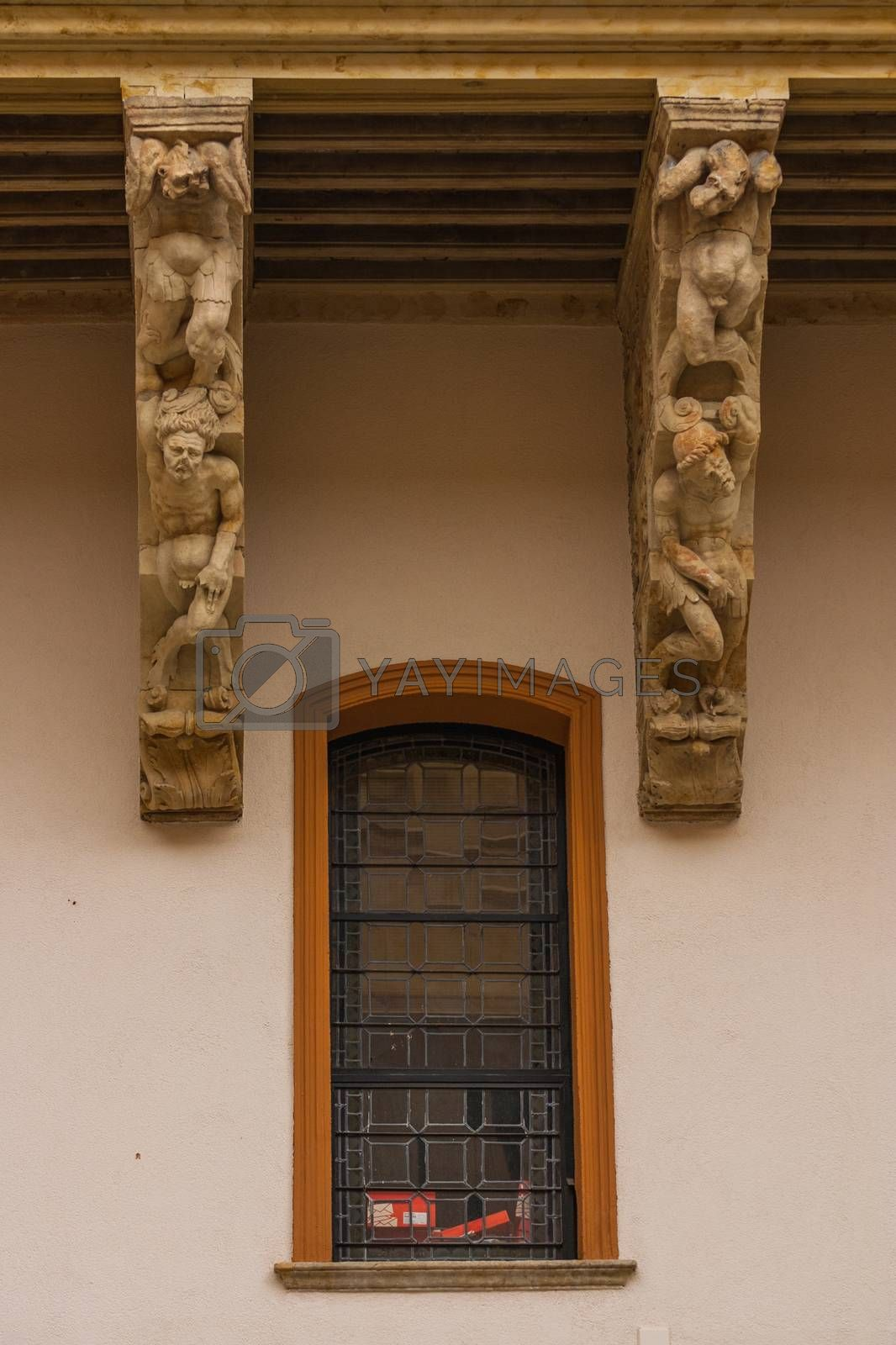 Twisted bodies  carved in the corbels of Salina Palace courtyard located in Salamanca Spain