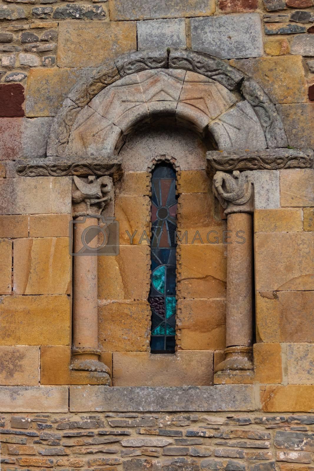 Delicate and beautiful romanesque window of the church of San Andres de Valdebarzana in Asturias Spain