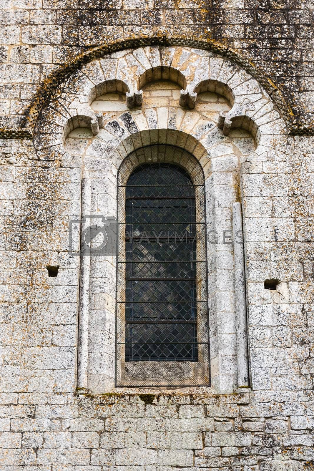 beautiful romanesque window in the romanesque fortified church of Saint Amand de Coly in Dordigne ,France