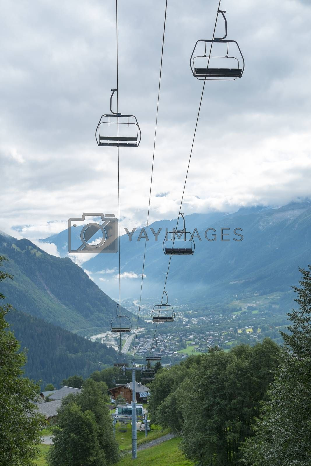 LES HOUCHES, FRANCE - AUGUST 23: Low angle shot of alpine air lift with Les Houches in the background. Les Houches is one of the Tour du Mont Blanc villages. August 24, 2014 in Les Houches.