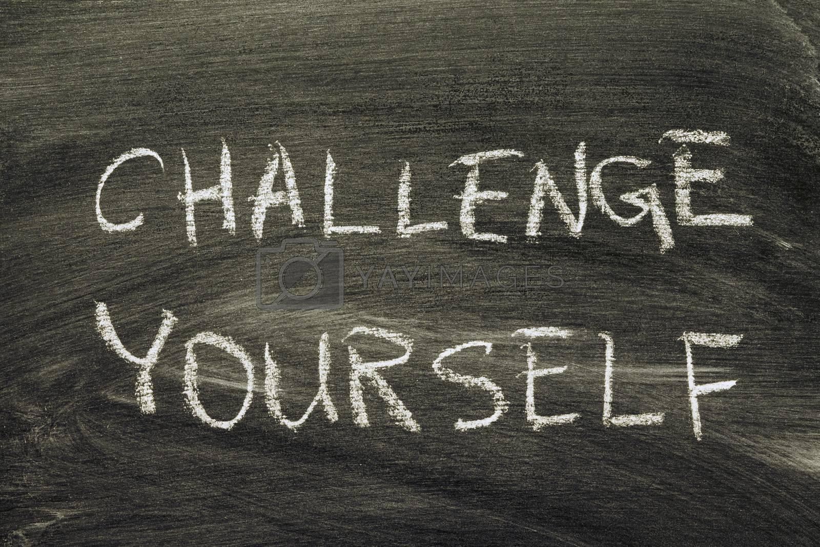 challenge yourself phrase handwritten on school blackboard