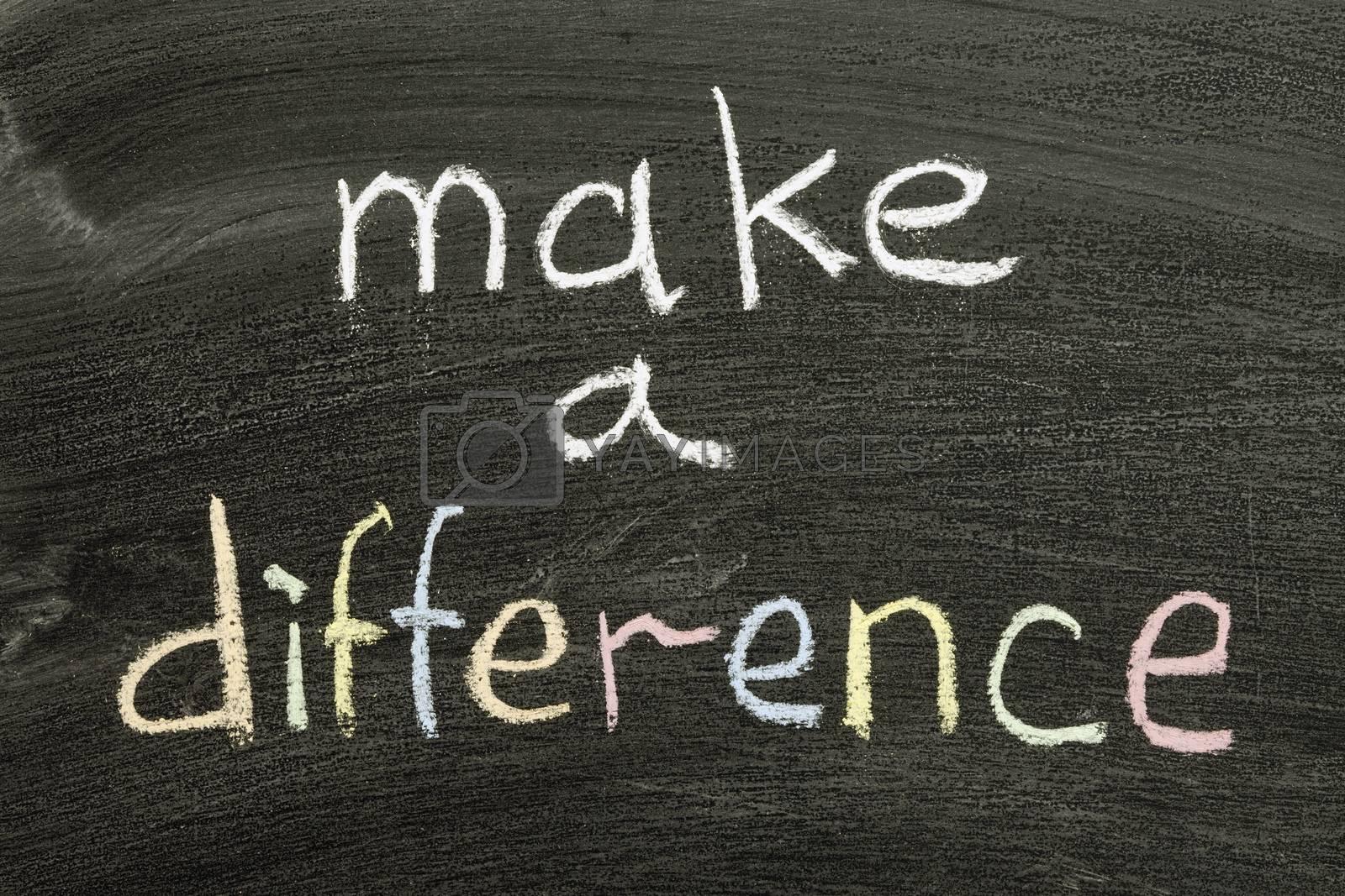 make a difference phrase handwritten on blackboard