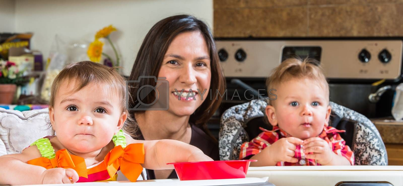 Mother Smiles With Babies by Creatista