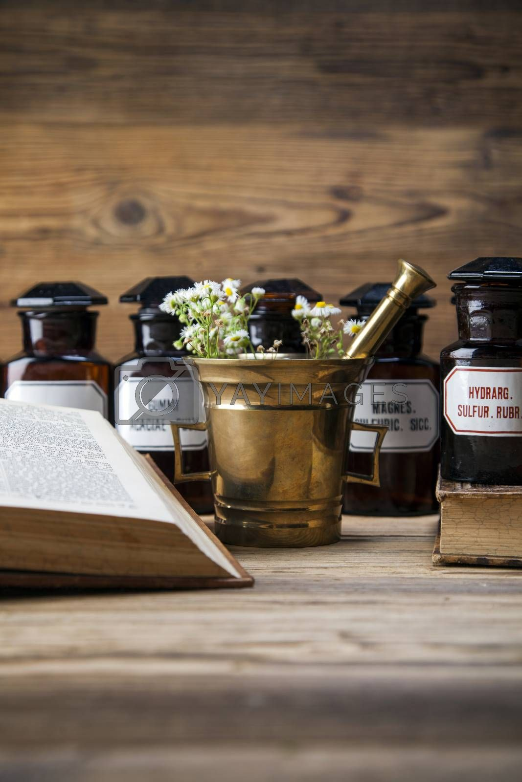 Royalty free image of The ancient natural medicine, herbs and medicines by fikmik