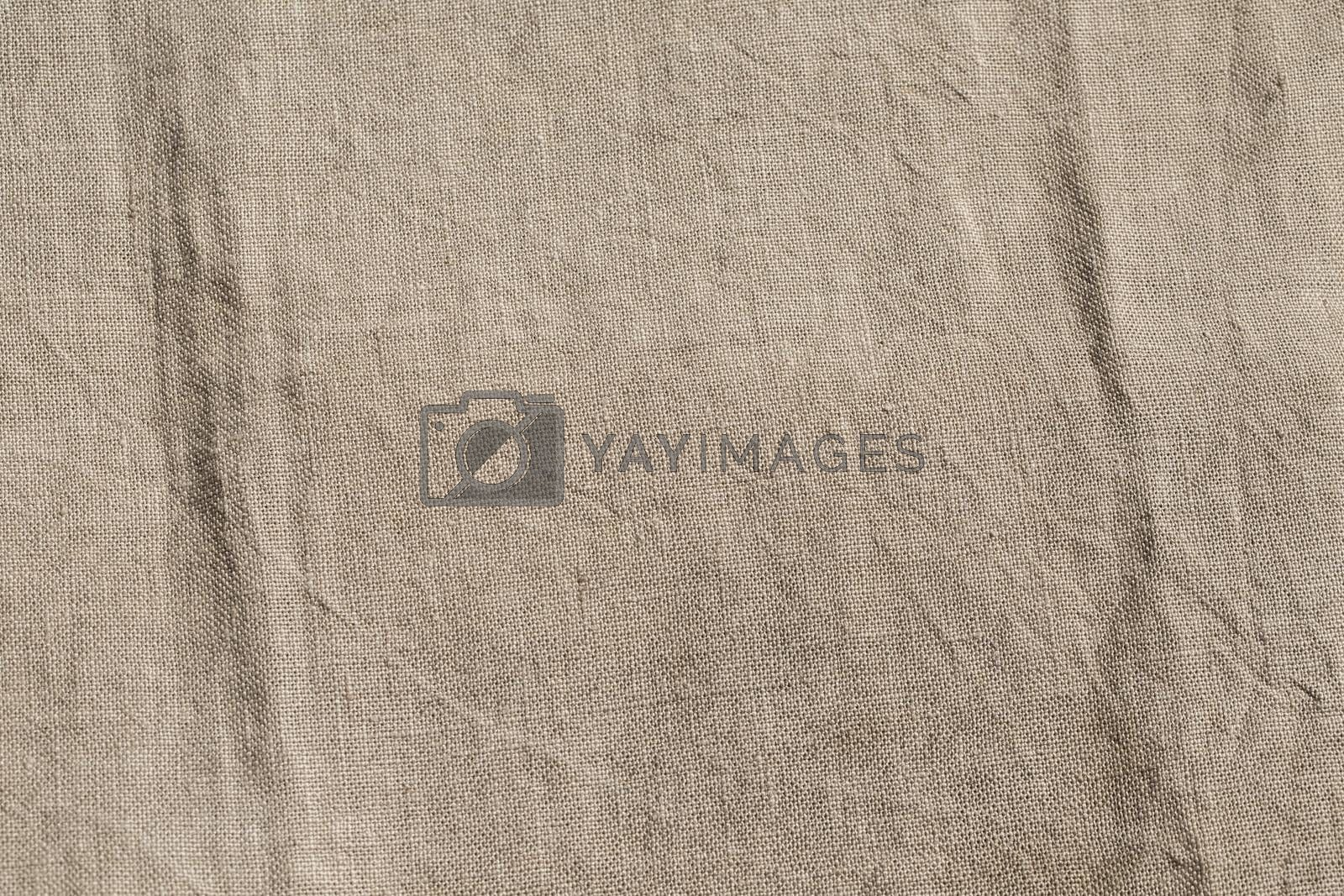 Close-up picture of a jute canvas with folds.
