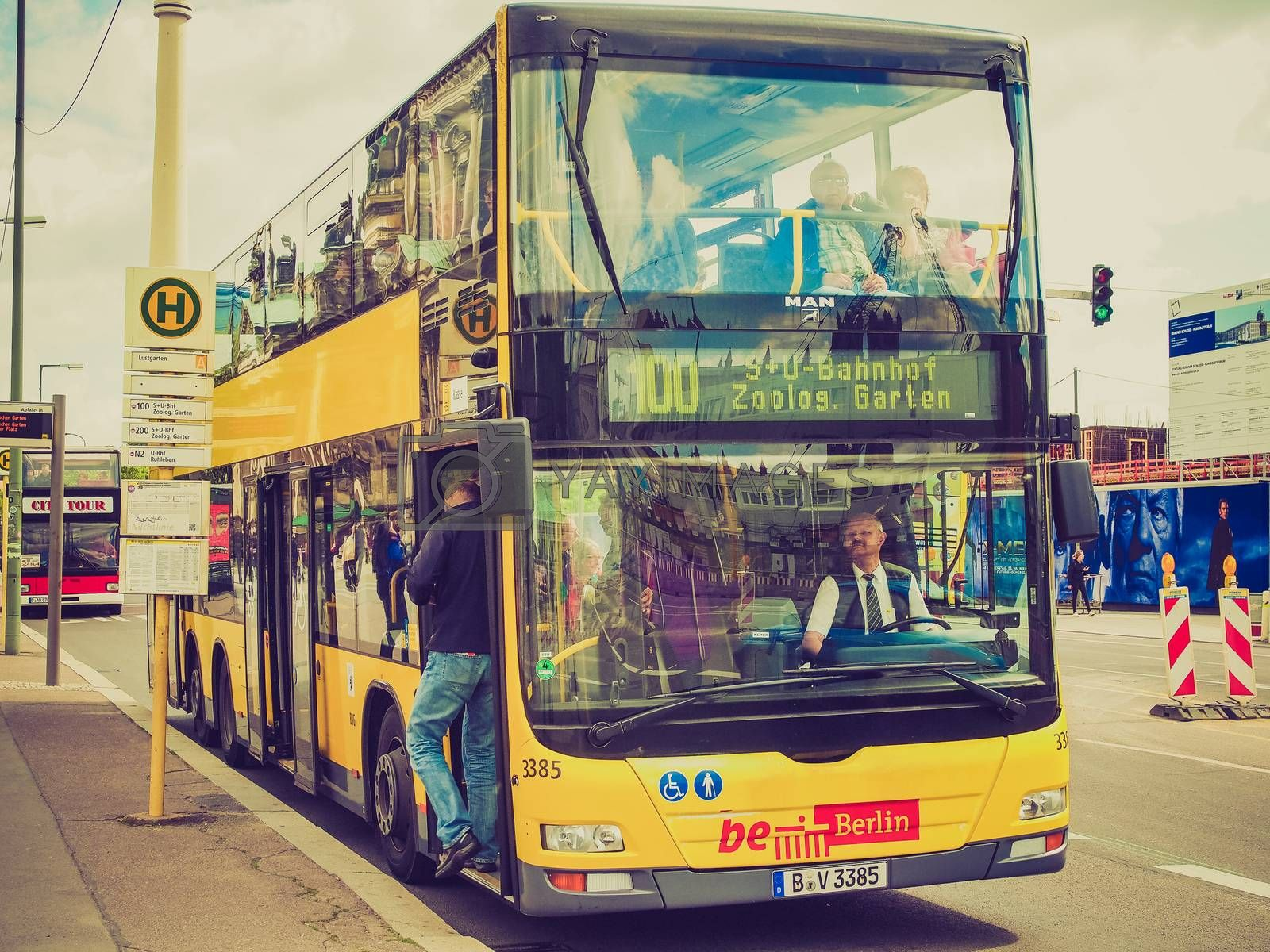 Vintage looking BERLIN, GERMANY - MAY 10, 2014: Tourists on BGV Bus for public transport