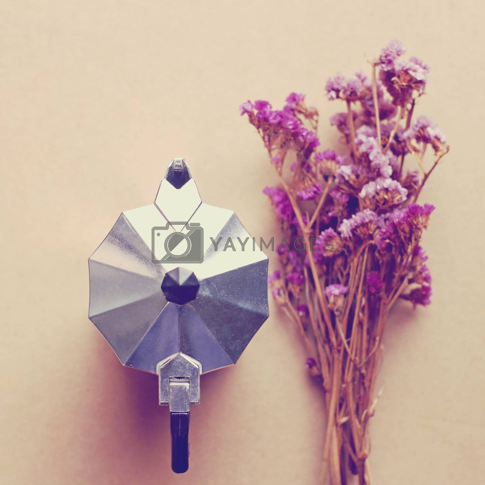 Italian coffee maker and flower with retro filter effect