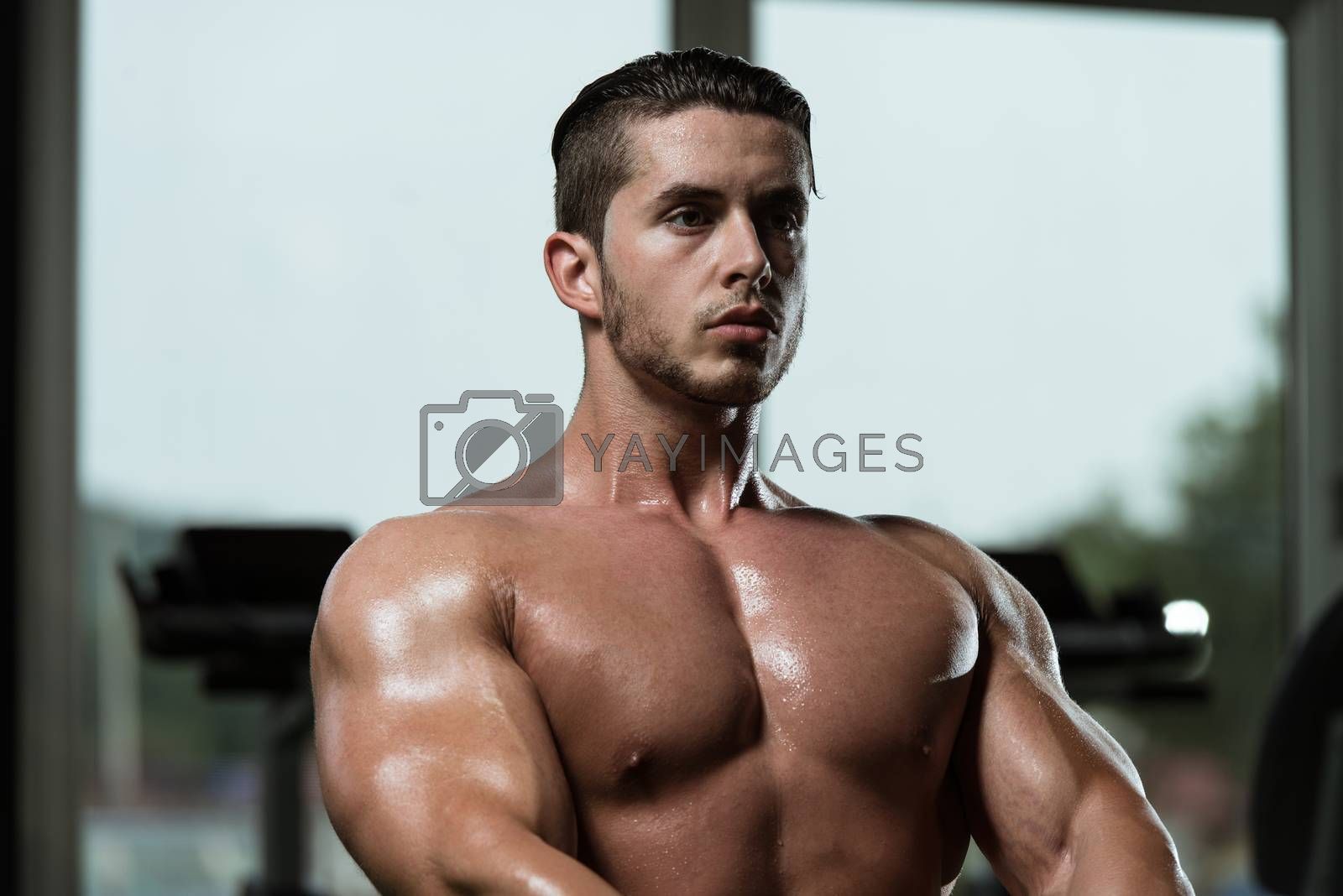 Young Bodybuilder Doing Heavy Weight Exercise For Back In Gym