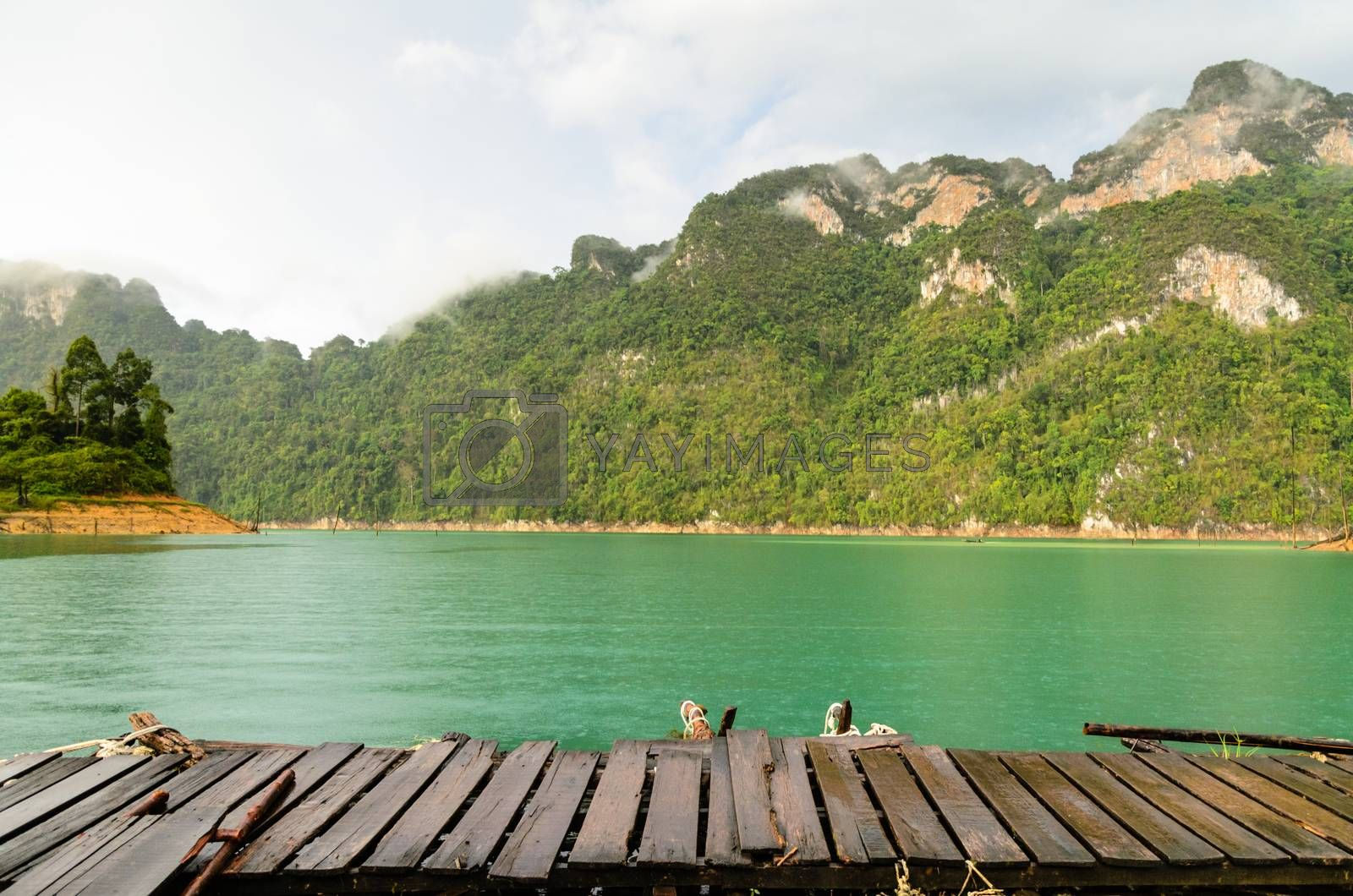 Mountain and river front of the hut while it was raining in Ratchaprapha Dam at Khao Sok National Park, Surat Thani Province, Thailand