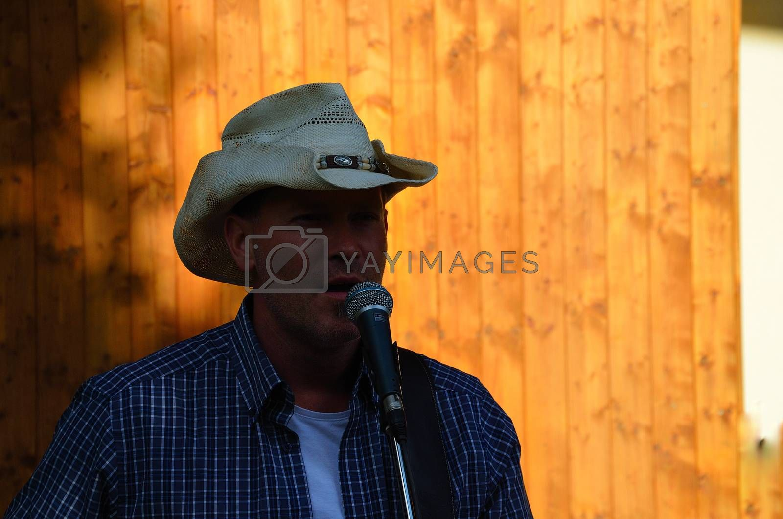 cowboy with hat and country music